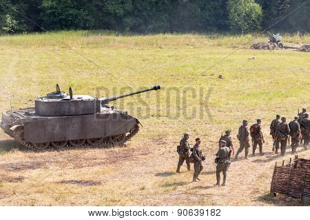 NELIDOVO, RUSSIA- JULY 12, 2014: Battlefield 2014: Nazi tank and infantry unit