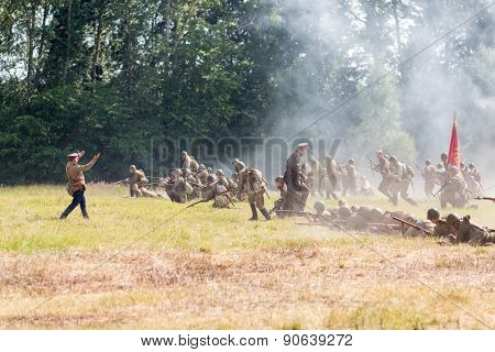 NELIDOVO, RUSSIA- JULY 12, 2014: Battlefield 2014: Red Army soldiers in the attack