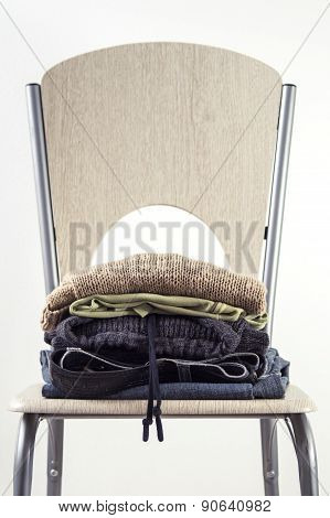 Stack Of Clothes On A Wooden Chair