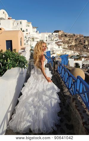 Runaway Bride In A Wedding Dress In Santorini In Greece