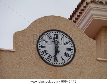 A clock on a yellow building