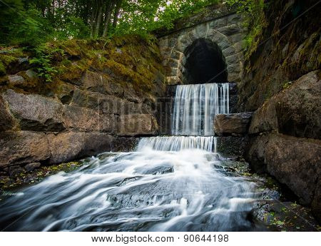 Waterfall at the end of a tunnel