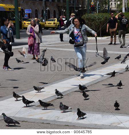 Girl Chasing Pigeons