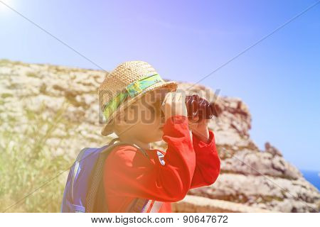 little boy travel in mountains