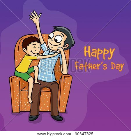 Young man with his cute son sitting on a sofa for Happy Father's Day celebration.