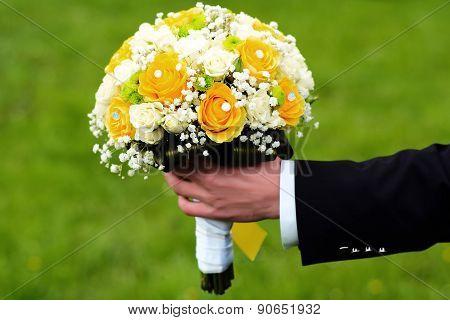 Fiance Holding A Bright Wedding Bouquet