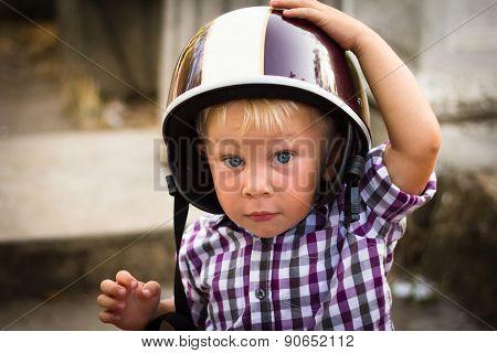 Child with motorbike helmet