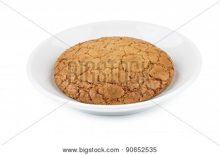 One Cookie In Saucer Isolated On White