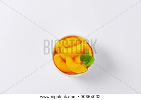 overhead view of peach compote served in the bowl