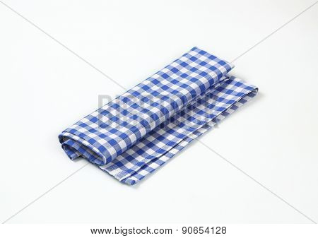 blue and white checkered tablecloth on white background