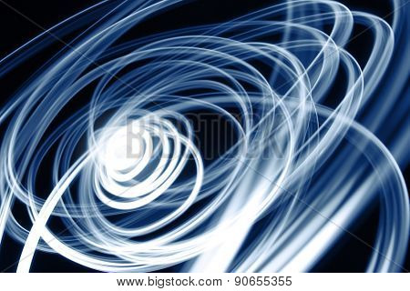 Blue swirly lines on black background