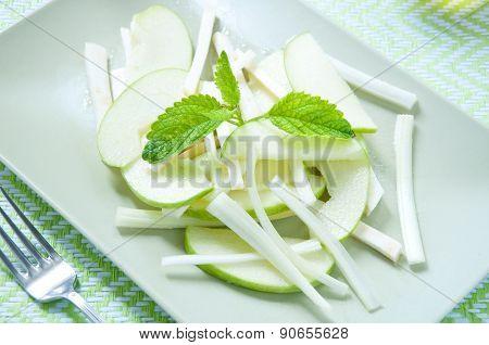 Fresh salad and green celeriac celery and green apple