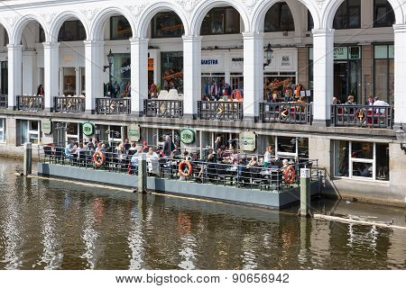 People Sitting At Floating Terrace  In Hamburg, Germany
