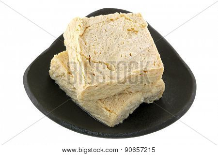 Closeup photography of fresh Japanese Snow tofu, isolated on white