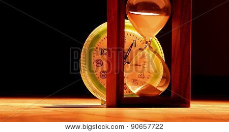 Hourglass and clocks