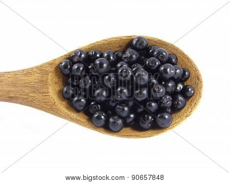 Jambolan plum or Java plum on wooden spoon
