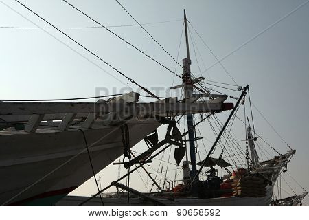 JAKARTA, INDONESIA - AUGUST 16, 2011: Wooden sailing ships called pinisi in the historical port of Sunda Kelapa in Jakarta, Central Java, Indonesia.
