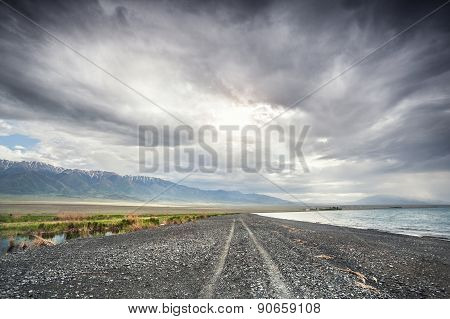 Road Between Mountains And Lake