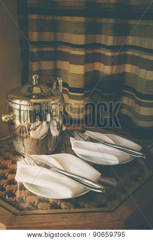 Stainless Ice Bucket And Table Setting With Sunlight