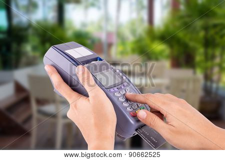 Woman Hand With Credit Card Swipe Through Terminal For Sale In Restaurant