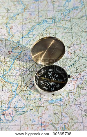 Geographical Map And A Compass.