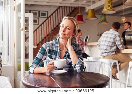 Adult woman in a cafe