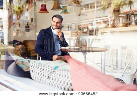 Young man sitting in a cafe