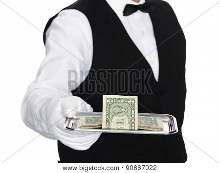 Butler holding tray with dollars
