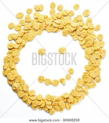 Cornflakes arranged as smiley face on a white background.