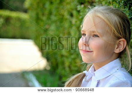Little schoolgirl  in profile.