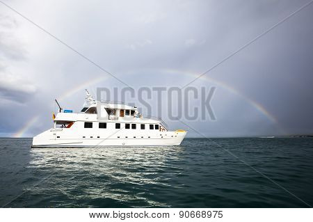 Rainbow And Yacht