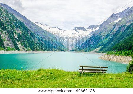 Lake Schlegeis and empty desk, Alps, Austria