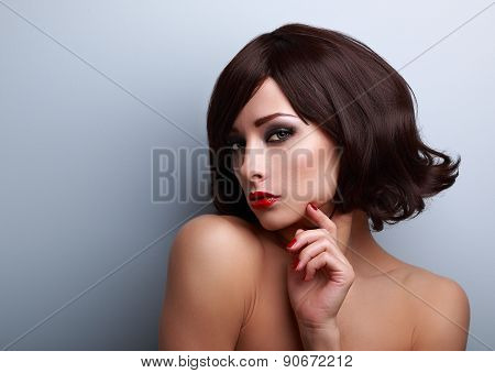 Beautiful Makeup Woman With Short Hairstyle And Red Nails Gloss