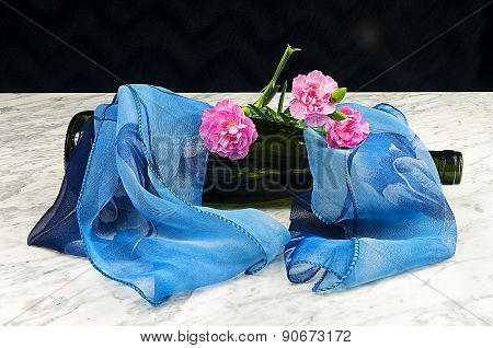 Carnations With A Bottle And A Blue Scarf