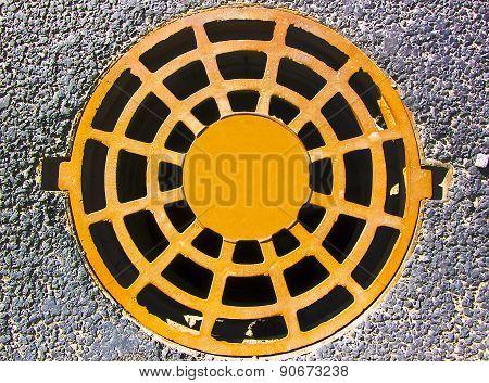 Manhole cover on the asphalt