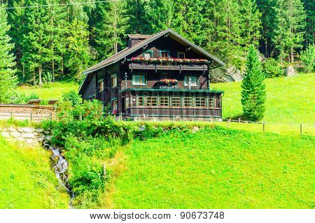 Wooden cabin and alpine meadows in Austria