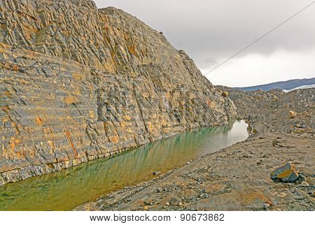 Bare Rock Wall After A Glacier Melts