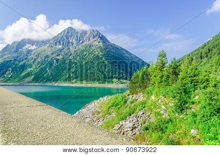 Dam and azure mountain lake  Alps, Austria