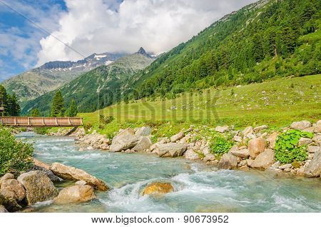 Mountain stream and peaks of Alps, Austria