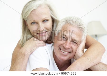 Portrait Of Romantic Senior Couple At Home