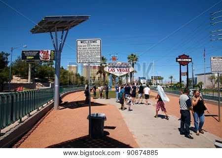 May 15, 2015 Las Vegas, Nevada.  People from around the world congregate around the World Famous Las Vegas Sign for Photo Ops as they enter Las Vegas on Vacation and for Conventions.
