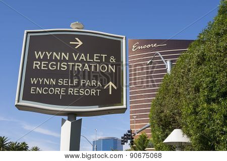 The Wynn valet and registration hotel sign with the Encore hotel in the background.
