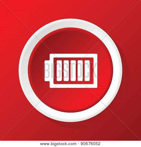 Charged battery icon on red
