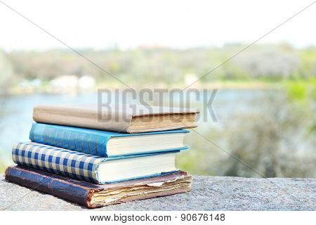 Stacked books on bright background