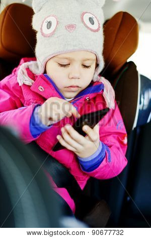 Girl Playing Smartphone In  Car