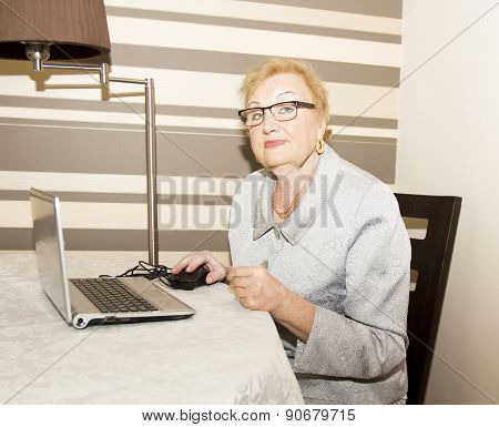 Elderly Lady With Notebook.