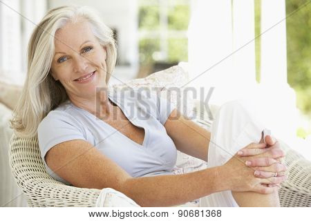 Senior Woman Sitting Outside