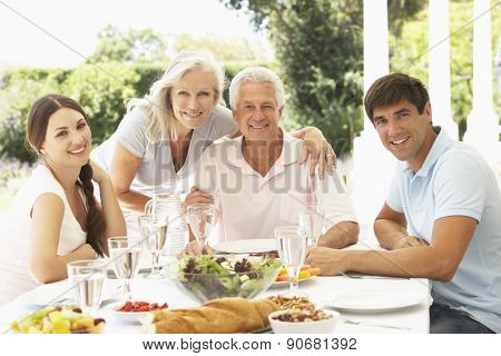 Parents and Adult Children enjoying Al Fresco Meal