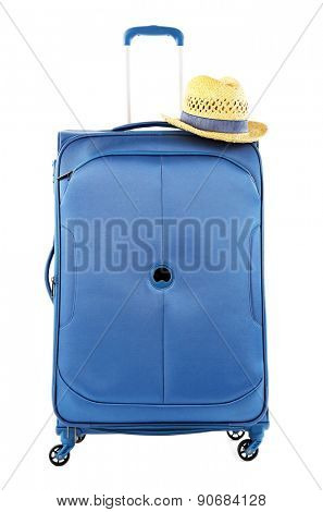 Blue suitcase with hat isolated on white