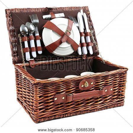 Wicker picnic basket with tableware isolated on white